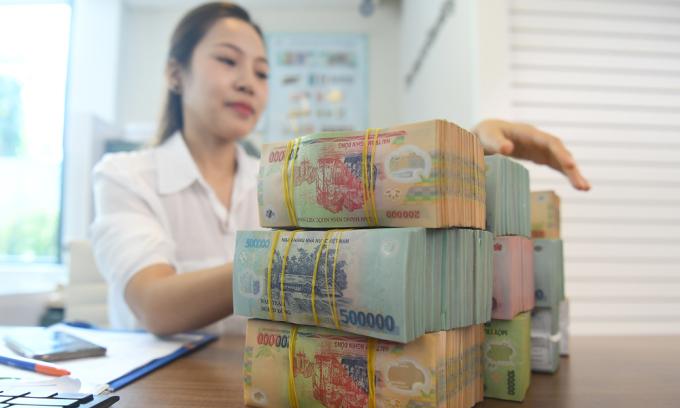 Ngân hàng có thể giảm lãi sau trích lập nợ tái cơ cấu vì Covid-19