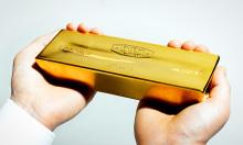 Giá vàng, chứng khoán Mỹ khép lại tuần sụt giảm